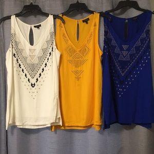 Three ladies sleeveless shirts
